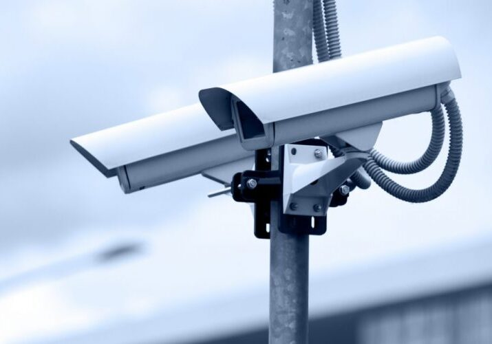 two cctv security cameras mounted on pole